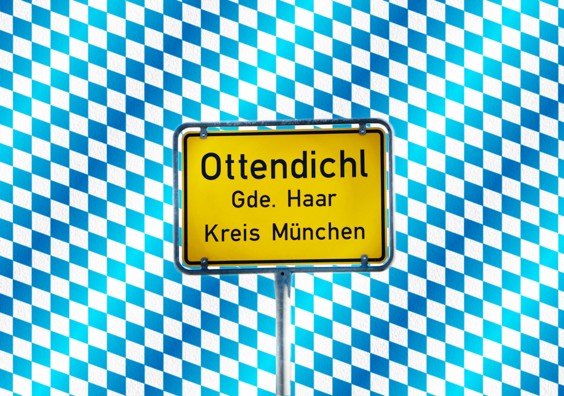 Ortsschild der Bürgervereinigung Ottendichl e.V. (BVO) vor bayerischem Rautenmuster